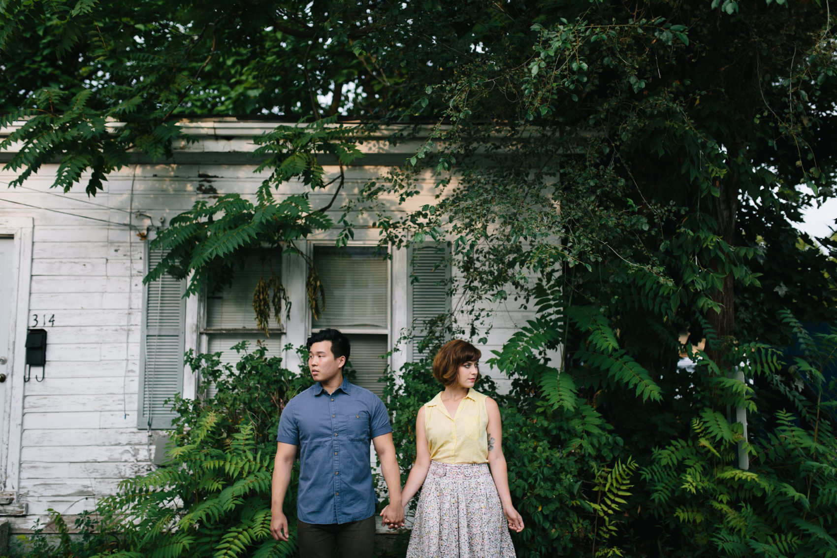 Couple stands in front of an old house in Ypsilanti, Michigan
