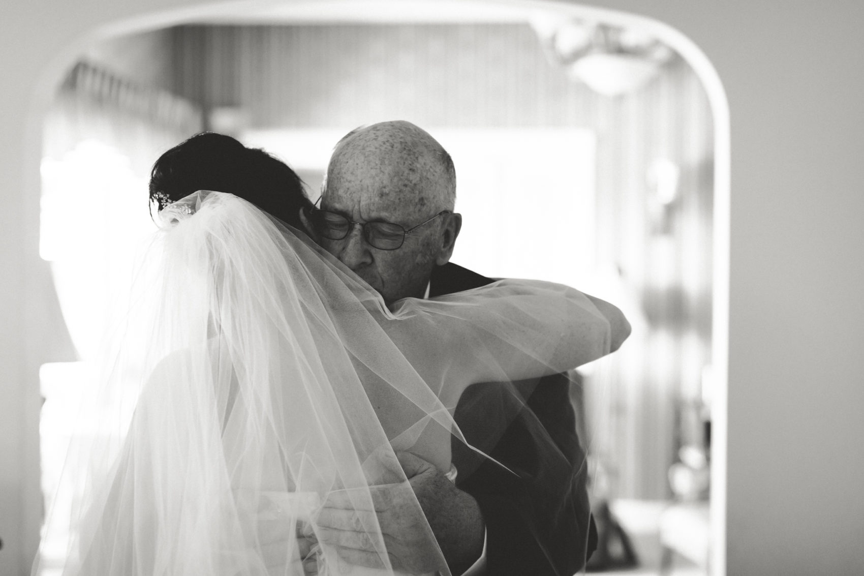 Father hugs bride on her wedding day in Morenci, Michigan
