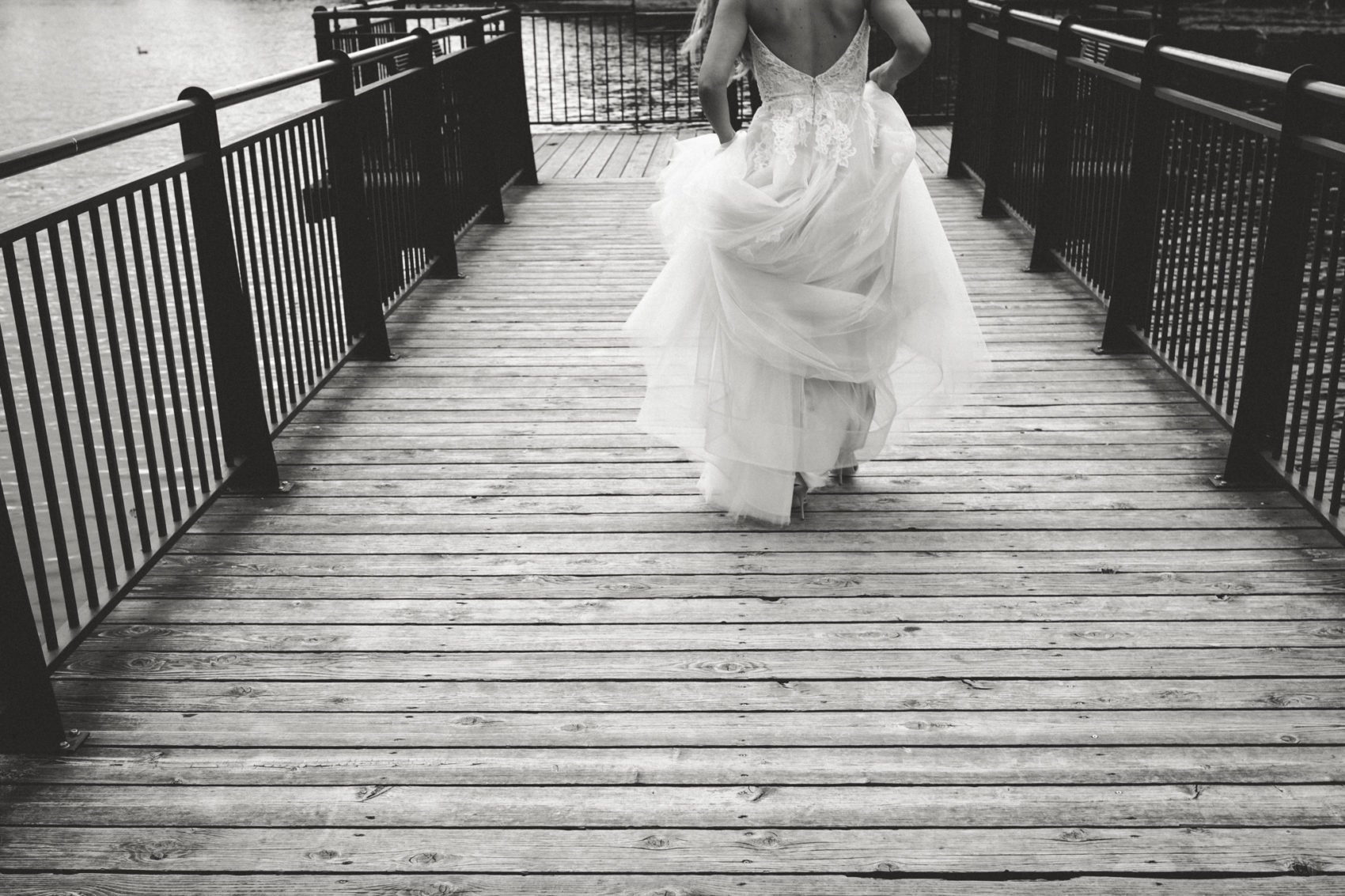 Bride walks out on a pier in her wedding gown in Detroit, Michigan